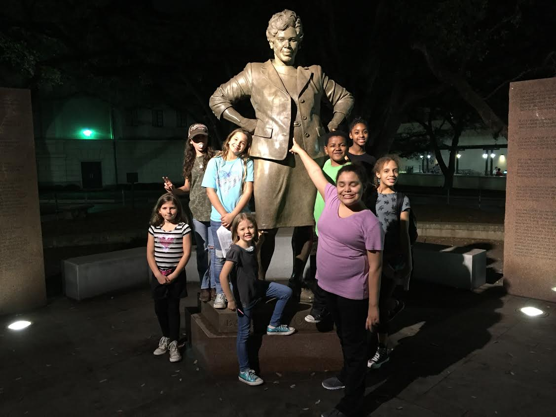Creative Action students with Barbara Jordan's statue at UT Austin.
